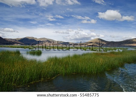 Lake Titicaca is a lake located on the border of Peru and Bolivia. It sits 3,812 m above sea level, making it one of the highest commercially navigable lakes in the world. - stock photo