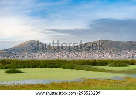 Lake Titicaca with Puno 's city view, Peru - stock photo