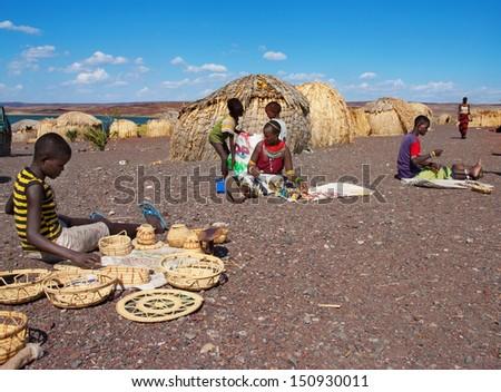 LAKE TURKANA, KENYA-JANUARY 12: El molo people sells traditional souvenirs January 12, 2013 near lake Turkana, Kenya. The El molo are one of the disappearing tribes of Africa.  - stock photo