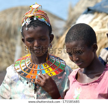 LAKE TURKANA, KENYA-JANUARY 12: Unidentified El molo women  near lake Turkana on January 12, 2013 , Kenya. The El molo are one of the disappearing tribes of Africa.  - stock photo