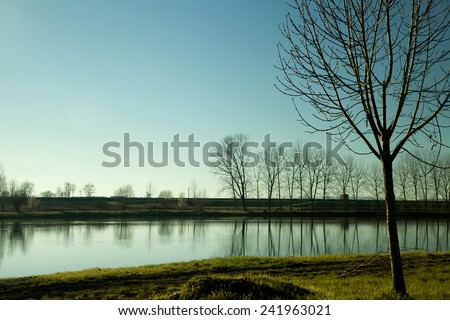 Lake under a sunset light, landscape view - stock photo