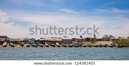 LAKE VICTORIA, UGANDA - OCT 19: Small fishing village on an island on October 19, 2012, Lake Victoria, Uganda, Africa. Fishing is the most important souce of income for local people at Lake Victoria. - stock photo
