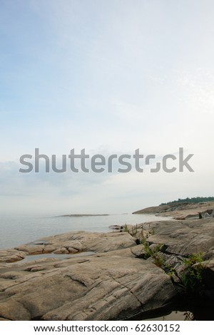 Lake viewed from the rocky coastline close to Karlstad, Sweden - stock photo
