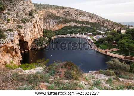 Lake Vouliagmeni, Athens. Its water maintains a constant 24 degrees Celsius temperature and functions as a spa - stock photo