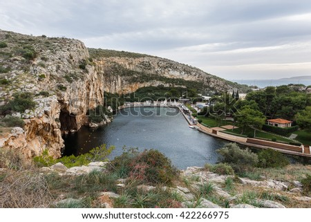 Lake Vouliagmeni on January 2016, Athens. Its water maintains a constant 24 degrees Celsius temperature and functions as a spa - stock photo