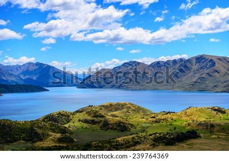 Lake Wanaka and Mt Aspiring, New Zealand lake hill field - stock photo
