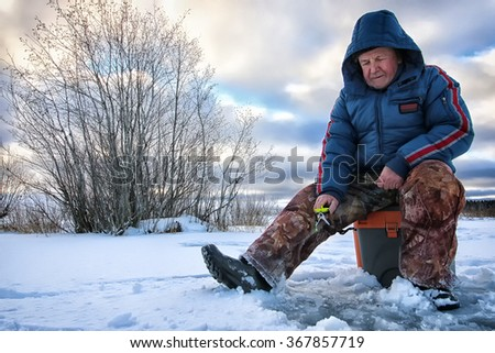 Lake Winter Fisherman