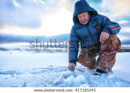 Lake Winter Fisherman - stock photo