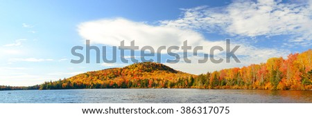 Lake with Autumn foliage and mountains in New England Stowe - stock photo