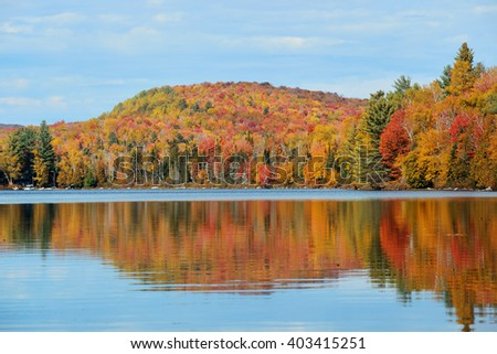 Lake with Autumn foliage and mountains with reflection in New England Stowe - stock photo