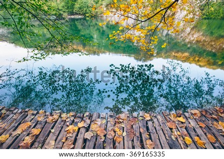 Lake with crystal clear water in the sunshine. Plitvice lakes, Croatia - stock photo
