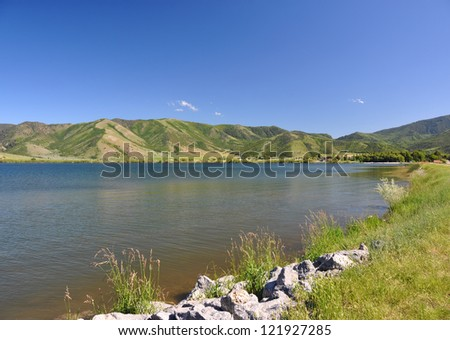Lake with mountains in the distance in Utah - stock photo