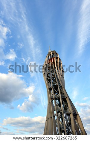 LAKE WORTH, AUSTRIA-SEPTEMBER 28, 2015: The Pyramidenkogel is  tallest wooden observation tower contains the tallest building slide in Europe. Its height is 27 meters. - stock photo