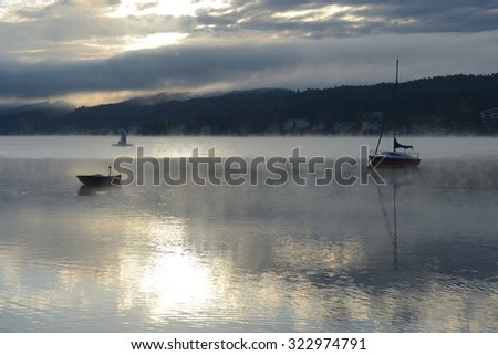 Lake Worth (Worthersee) at sunrise. Austria - stock photo