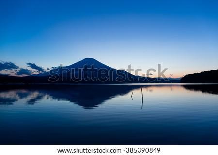 Lake Yamanaka with mountain Fuji at sunset - stock photo