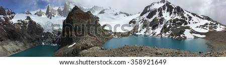 Lakes below cloud-covered Fitz Roy in Argentina - stock photo