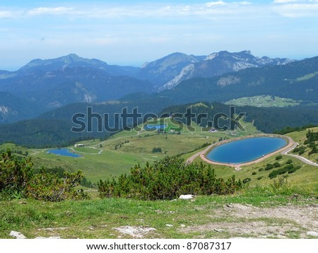 Lakes in the Alps artificially produced for the cows. - stock photo