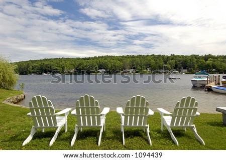 Lakeside ardirondack chairs. - stock photo