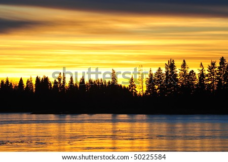 lakeside sunset view in elk island national park, alberta, canada - stock photo