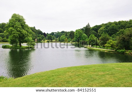 Lakeside View of an English Landscape Garden - stock photo