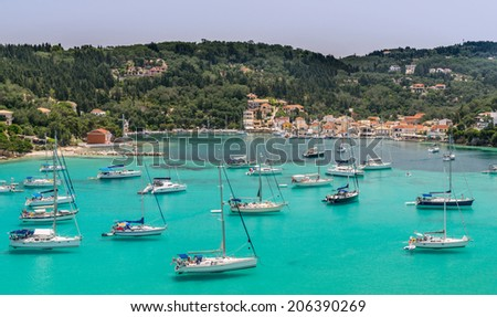 Lakka Bay on the island of Paxos is a major stopping point for sailors in the Ionian Sea - stock photo