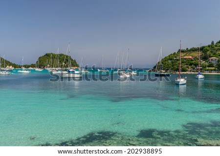 Lakka Bay one of the major mooring points for sailing around the Ionian Islands - stock photo