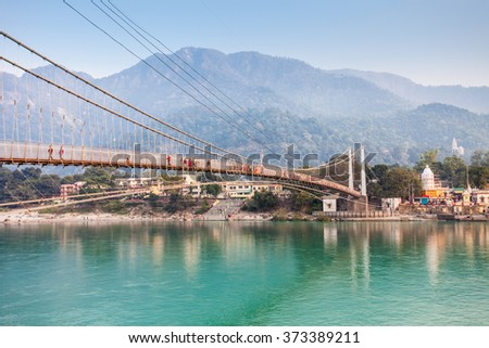 Lakshman Jhula is an iron suspension bridge situated in Rishikesh, Uttarakhand state of India. - stock photo