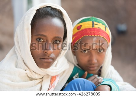 LALIBELA, ETHIOPIA - 06 JANUARY 2016: Portrait of two girls sitting outside one of the stone churches.