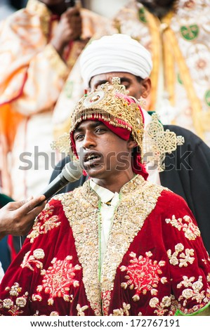 LALIBELA, ETHIOPIA - SEP 27, 2011: Unidentified Ethiopian religious man watching the Meskel festival performance in Ehtiopia, Sep 27, 2011. Meskel commemorates the finding of the True Cross