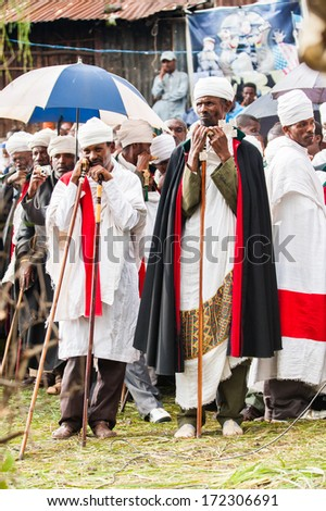 LALIBELA, ETHIOPIA - SEP 27, 2011:  Unidentified people with bright clothes and umbrellas during the Meskel festival performance in Ehtiopia, Sep 27, 2011.Meskel commemorates finding of the True Cross