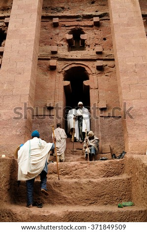 LALIBELA, ETHIOPIA - SEPTEMBER 02: Ethiopian pilgrimS is praying in the complex of temples in solid rock in Lalibela, Ethiopia in Lalibela in September 02, 2013 - stock photo