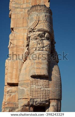 Lamassu guarding the Gate of Xerxes Palace in the ruins of Persepolis in Shiraz, Iran. - stock photo