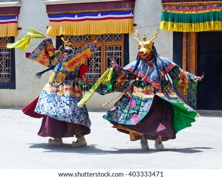 LAMAYURU, INDIA - JUNE 17, 2012: Buddhist monks in Deer mask dancing Cham mystery during Yuru Kabgyat festival at Lamayuru Gompa in Ladakh, Jammu and Kashmir, North India - stock photo