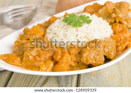 Lamb and sweet potato peanut stew served with white rice. Caribbean and West African dish. - stock photo