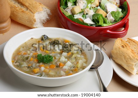 Lamb and vegetable soup with salad and bread