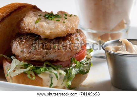 Lamb burger with yucca fries and mayonnaise - stock photo