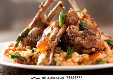 Lamb Chops with spicy rice and vegetables - stock photo