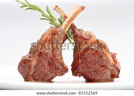 Lamb loin with thyme elegantly served on a white background isolated