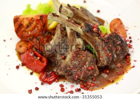 Lamb Rack - grilled,with sauce,peppercorn,baked tomato - stock photo