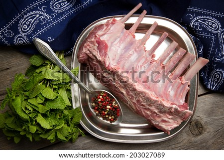 Lamb ribs, pepper and mint - stock photo
