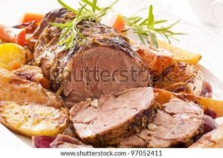 Lamb roast with vegetables - stock photo