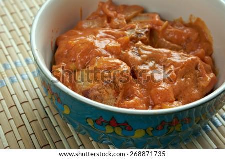 Lamb Rogan Josh - lamb dish of Persian origin, which is one of the signature recipes of Kashmiri cuisine. - stock photo