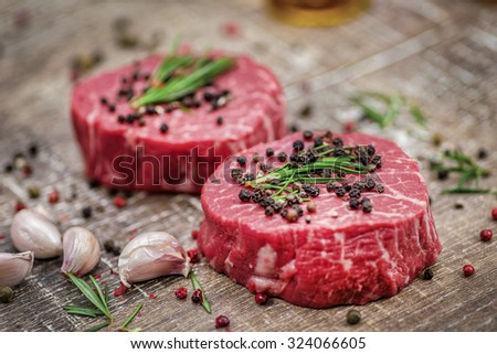 Lamb steaks. Fresh and beautiful fillet of lamb on a wooden table. Delicious meat sheep. - stock photo