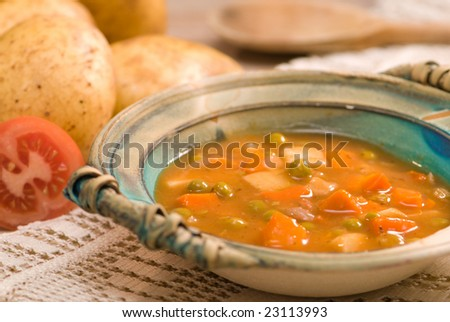 Lamb stew in rustic setting, shallow dof - stock photo