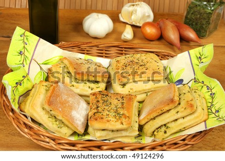 Laminar bread rolls with garlic and parsley in basket with decoration