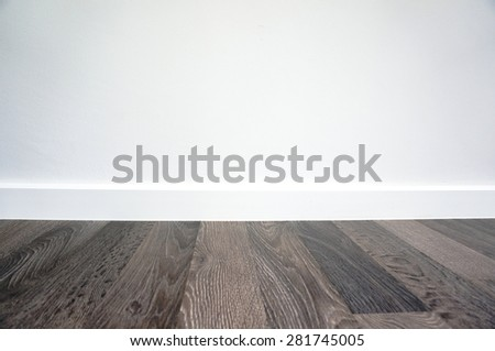 laminate floor and white wall - stock photo
