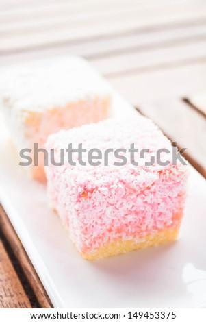 Lamington cakes on wood table, stock photo - stock photo