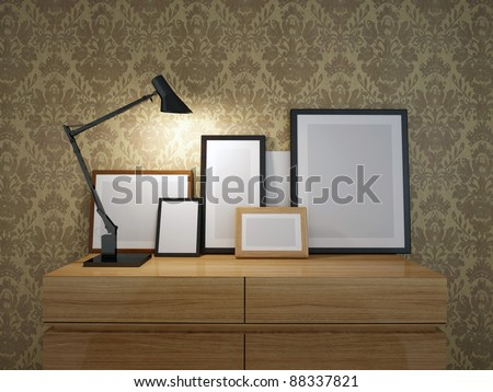 Lamp and frame on wood sideboard. your own designs to the frames. - stock photo