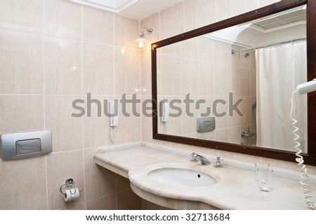 Lamp and mirror on a wall of bathroom