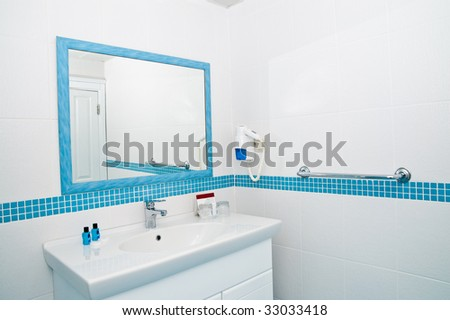 Lamp and mirror on a wall of bathroom - stock photo